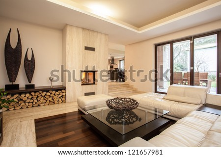 Travertine house: interior of beige living room #121657981