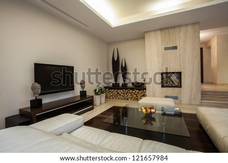 Travertine house: Spacious living room in horizontal view - stock photo