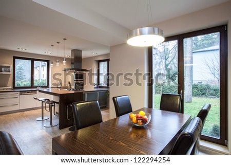 Travertine house - view of a dining room and kitchen