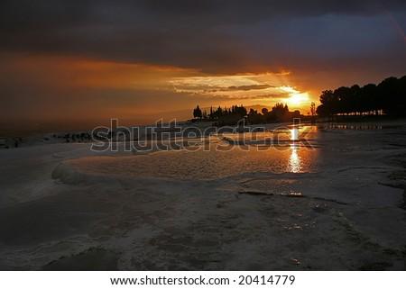 travertine pools and terraces at sunset Pamukkale, Denizli, Turkey