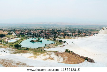 Travertines of Pamukkale and old town in Turkey #1157912815