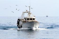 Trawler fishing boat sailing in open waters