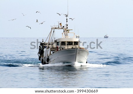 Trawler fishing boat sailing in open waters