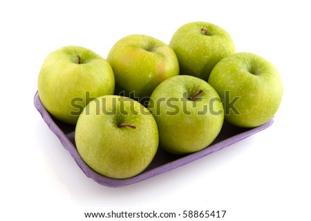 Tray fresh green apples isolated over white