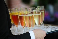 Tray of colorful glasses filled with Champagne