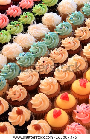 Tray of colorful mini cupcakes