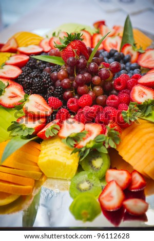 tray of various delicious, tropical fruits