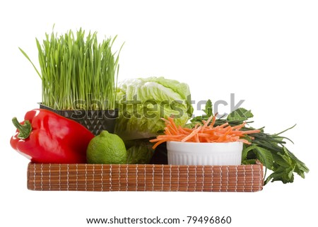 Tray of vegetables isolated on a white background.