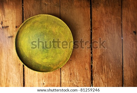 Tray on wooden surface, good as background or something similar.