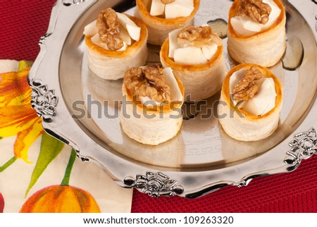 Tray with a serving of stuffed vol au vents