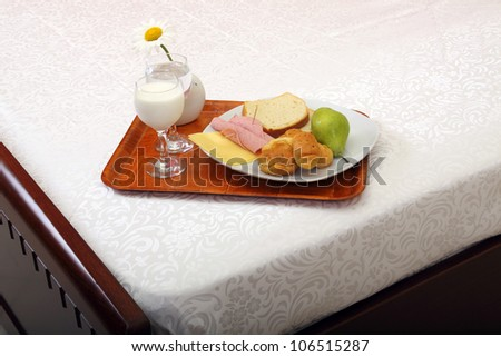 tray with breakfast on bed