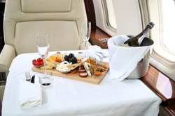 Tray with delicious food on the plane, business class travel