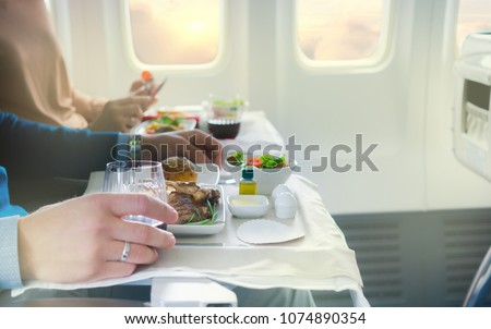 Tray with delicious food on the plane, business class travel.  #1074890354
