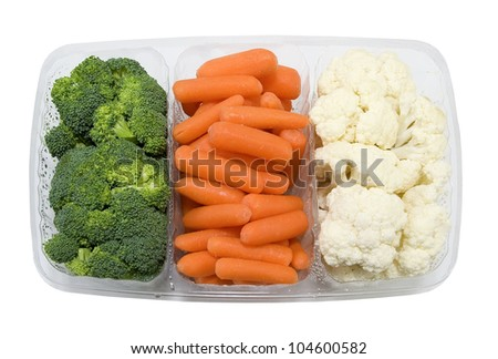 tray with fresh broccoli, carrots and cauliflower on a white background