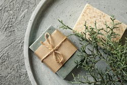 Tray with natural handmade soap on gray background