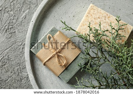 Tray with natural handmade soap on gray background Photo stock ©