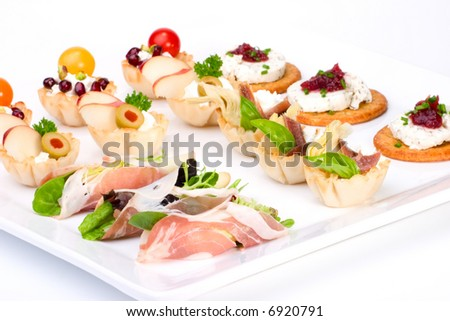 Tray with ready-to-eat fresh sandwiches on holiday table over white background #6920791