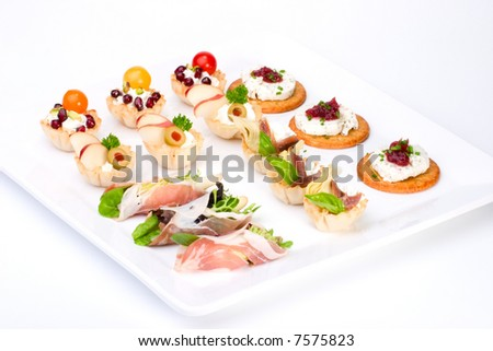 Tray with ready-to-eat fresh sandwiches on holiday table over white background #7575823