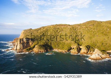 Treacherous Knysna Heads. Looking from East Head to West Head with caves in Featherbed Nature Reserve