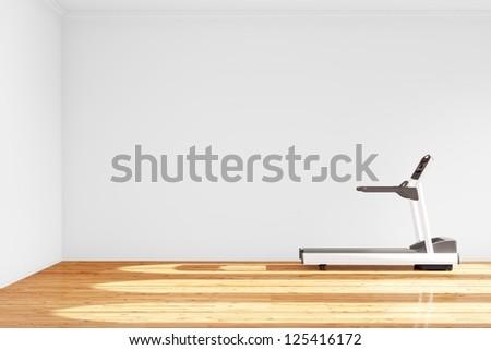 Treadmill in empty room with hardwood floor