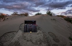 treasure chest at the beach in a sunrise, jewels and gold coins