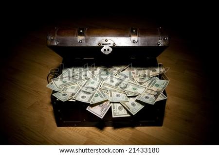 treasure chest full of money - stock photo