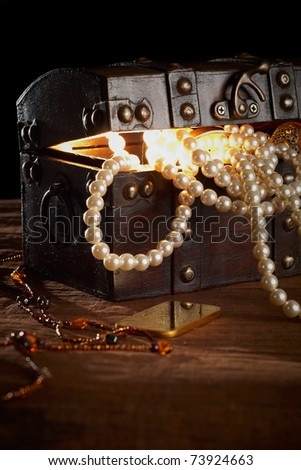 treasure chest with gold and pearls