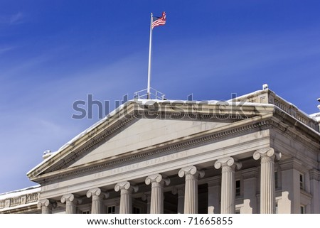 Treasury Department US Flag Columns After the Snow Pennsylvania Avenue Washington DC - stock photo