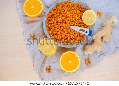 Treatment of colds with traditional medicine sea buckthorn tea.Ingredients for sea buckthorn tea with orange lemon and ginger root for the common cold #1571598472