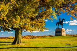 Tree and statue on a battlefield at Gettysburg, Pennsylvania.