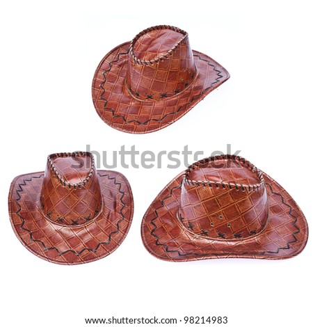 tree brown leather hat isolated on white  Traditional hat for all american cowboys
