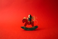 tree carving christmas concept toy on red background