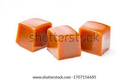 Tree cubes of caramel on white background. Isolated Stock photo ©