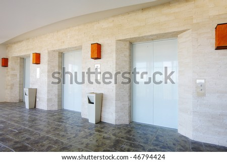 tree doors of elevator in contemporary style