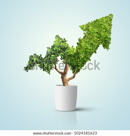 Tree grows up in arrow shape over blue background. Concept business image #1024181623
