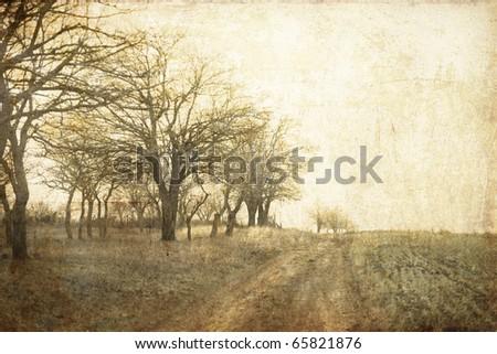 tree in the autumn field near...