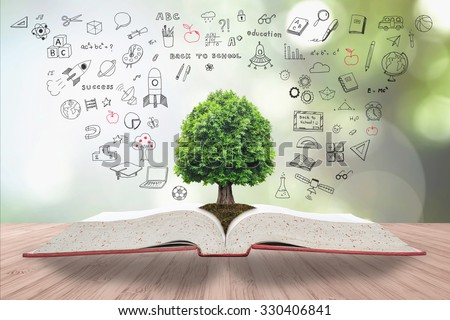 Tree of knowledge life growing on soil from big archive open textbook creative freehand doodle drawing on wooden table on blur natural green background. Educational arbor growth conceptual CSR idea #330406841