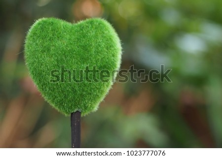 Tree of love./Green heart on nature background. #1023777076