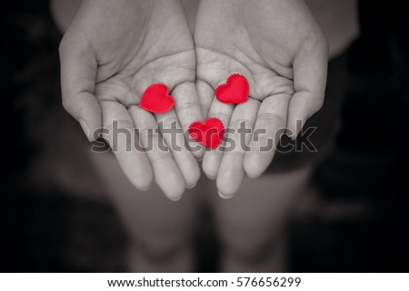 tree red heart in woman hand .sad love concept #576656299