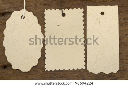 tree tags or labels on the wooden background - stock photo