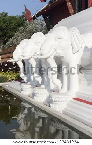 Tree white elephants sculpture