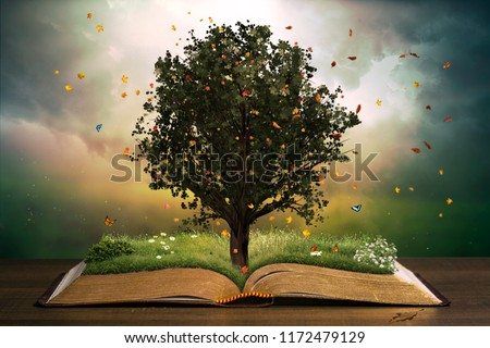 Tree with grass in a beautiful garden on an open book. Learning concept. #1172479129