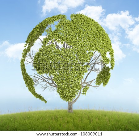 Tree with the leafs forming the world map on a hill - stock photo