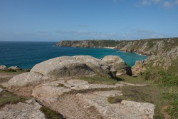 Treen Head or Treryn Dinas, the Ancient Site of an Iron Age Cliff Castle, with Porthcurno Beach and Minack Theatre in the Background on the South West Coast Path in Rural Cornwall