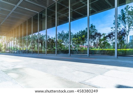 trees and blue sky reflected on clean glass wall,china. #458380249