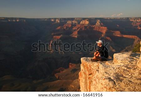 Trekker admiring Grand Canyon at sunset. Grand Canyon national park. Arizona. USA