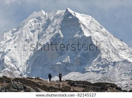 Trekkers against of snow-covered Island peak (6189 m)  - Nepal, Himalayas