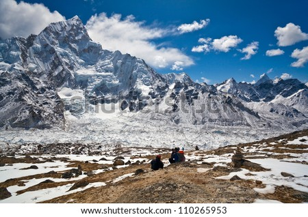 Trekkers going to see Mt. Everest up close attempt to climb to the top of Kala Patthar in Sagarmatha National park, Nepal