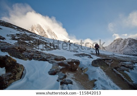 Trekkers going to see Mt. Everest up close attempt to climb to the top of Kala Patthar in Sagarmatha National Park, Nepal Himalaya