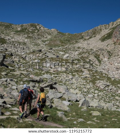 Trekkers on final ascent effort to Port de Caldes de Colomers mountain pass at 2,572 m ASL on trail GR11.18, Aiguestortes & Estany de Sant Maurici National Park, Pyrenees, Spain #1195215772